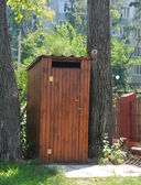Small wooden outdoors toilet in summer. — Stock Photo