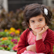 Angry and Thoughtful Caucasian Little girl in the Garden — Stock Photo
