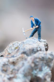 Figure of miner with pickaxe at work. — Stock Photo