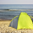 Colorful tent on the beach — Stock Photo
