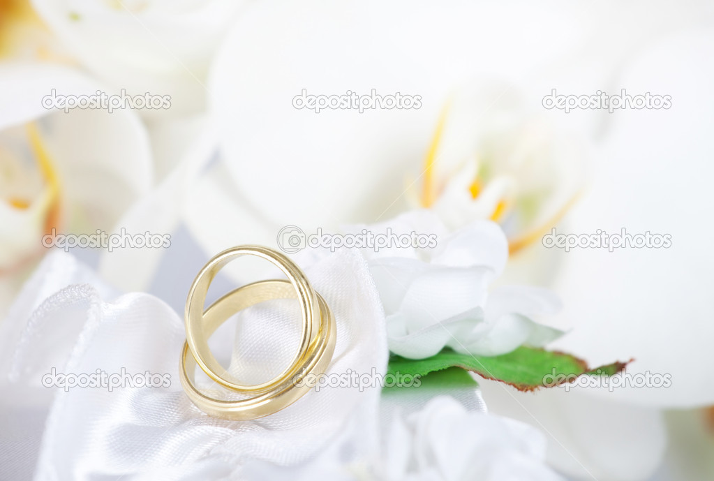 Close up on wedding bouquet and golden rings  Stock Photo #11981720