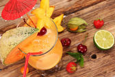 Cocktail on wooden background — Stock Photo