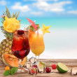 Fruit cocktails on the beach — Stock Photo