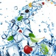Fresh fruit in water splash with ice cubes — Stock Photo #11604099
