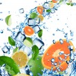 Fresh fruit in water splash with ice cubes — Stock Photo #11604119