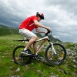 A man riding a mountain bike — Stock Photo