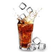 Cola glass with falling ice cubes over white — Stock Photo