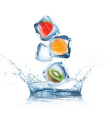 Fruit in ice cubes in motion — Stock Photo