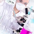 Young female scientist in a chemistry laboratory — Stock Photo