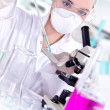 Stock Photo: Young female scientist in a chemistry laboratory