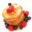 Small pancakes topped with honey — Stock Photo