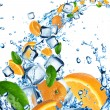 Fresh oranges in water splash with ice cubes — Stock Photo #11731274