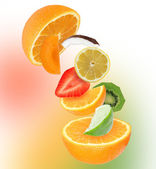 Sliced mixed fruit in motion. — Stock Photo