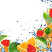 Fresh healthy fruit background with splashing water — Stock Photo