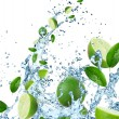 Fresh limes in water splash — Stock Photo