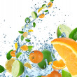 Fresh fruit in water splash — Stock Photo #12012521