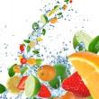 Fresh fruit in water splash — Stock Photo