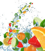 Fresh fruit in water splash — Stock Photo