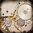 Stock Photo: Mechanical clockwork. Close up shot.
