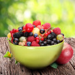 Stock Photo: Bowl with a variety of berries
