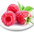 Larger image of raspberries on a plate. — Stock Photo