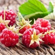 Raspberries with leaves — Stock Photo #11957261