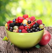 Bowl with a variety of berries — Stock Photo