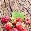 Raspberries with leaves - Stock Photo