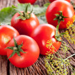 Tomatoes, cooked with herbs for preservation — Stock Photo #11997419