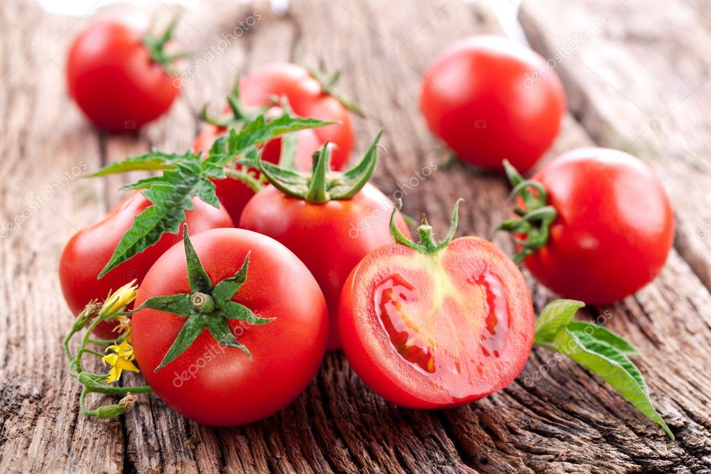 Tomatoes, cooked with herbs for the preservation on the old wooden table. — Stock Photo #11997434