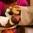 Foto Stock: Baptizing of baby
