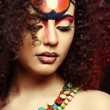 Beautiful African woman with artistic make-up — Stock Photo