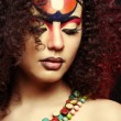 Beautiful Africwomwith artistic make-up — Stock Photo #11794468