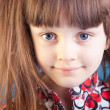 Beautiful little girl on a blue background — Stock Photo #11794502