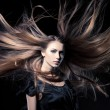 Closeup portrait of glamour young girl with beautiful long hair — Stok Fotoğraf #11794640