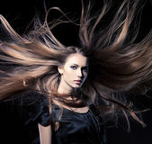Closeup portrait of glamour young girl with beautiful long hair — Photo