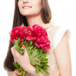Portrait of a beautiful girl with flowers on white background - Stock Photo