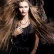 Closeup portrait of glamour young girl with beautiful long hair — Stock Photo #11943609