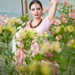 Stock Photo: Beautiful indian girl in the indian national dress on greenhouse