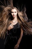 Closeup portrait of glamour young girl with beautiful long hair — Foto de Stock