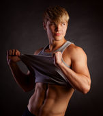 Beautiful young strong man posing on studio — Foto de Stock