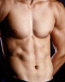 Muskulös ung sexig naken man på studio — Stockfoto