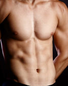Svalnatý mladý sexy nude muž na studio — Stock fotografie