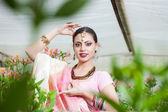 Beautiful indian girl in the indian national dress on greenhouse — Stock Photo
