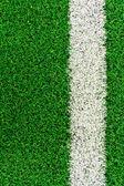 White stripe on the green grass field — Stock Photo
