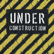 Under construction message on asphalt background. Vector, EPS8 — Stock Vector #11979031