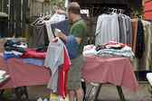 Man Holding Clothes at Sale — Stock Photo