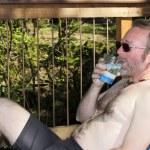 Shirtless Man Drinking Water — Stock Photo