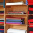 Textiles on Shelves - Stock Photo