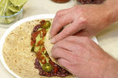 Rolling a Vegetarian Wrap — Stock Photo